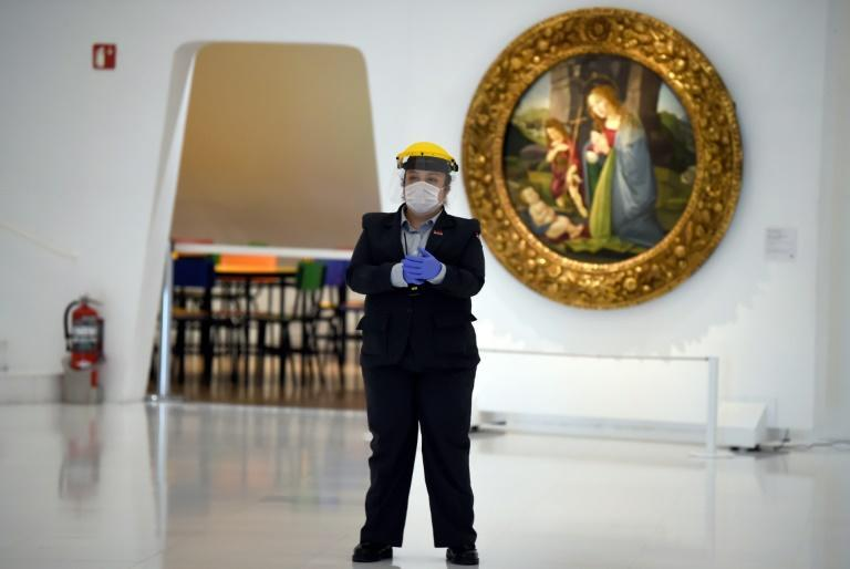 Security guards at Mexico City's Soumaya Museum are wearing face masks and shields for extra protection