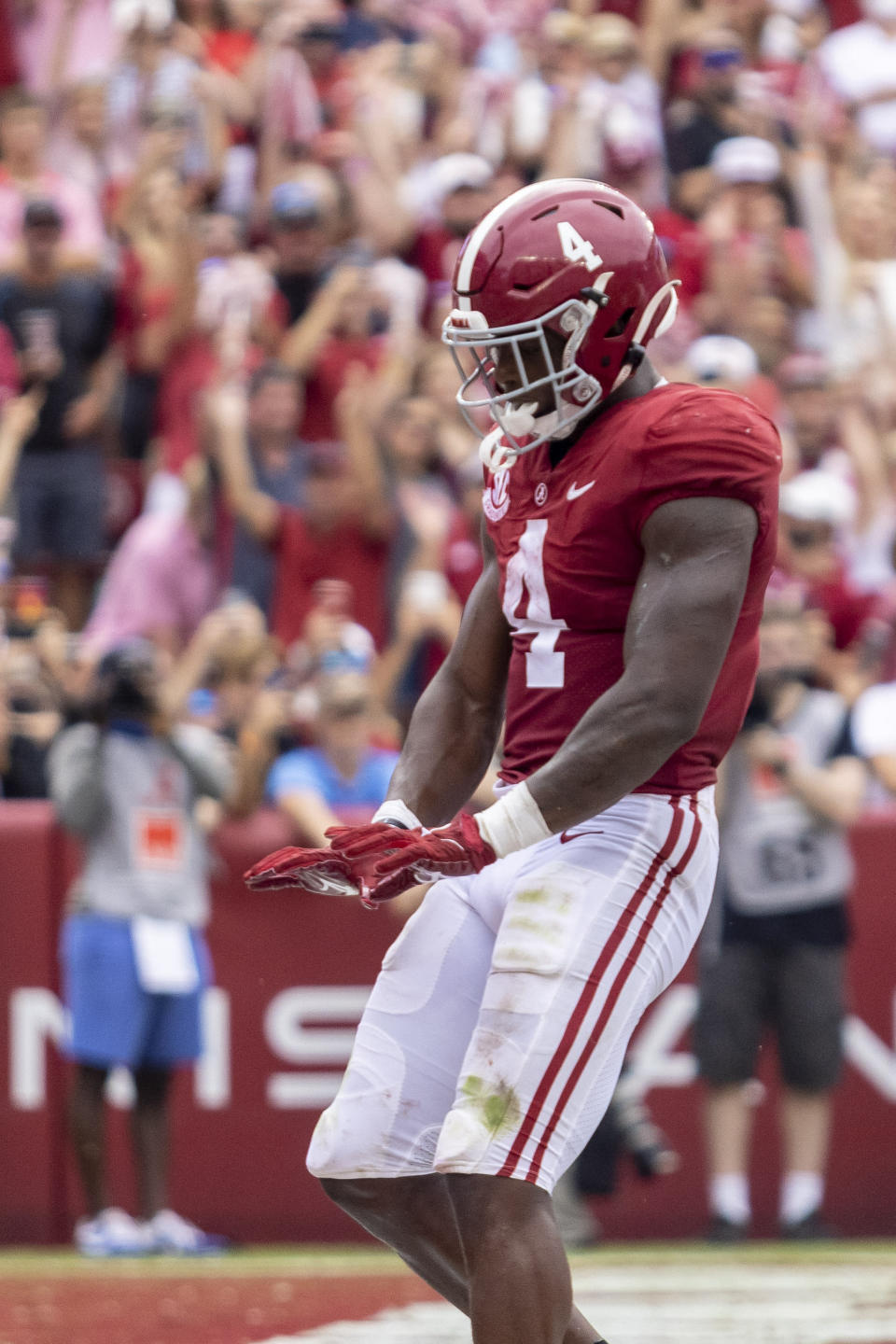 Alabama running back Brian Robinson Jr. (4) celebrates his touchdown run during the first half of an NCAA college football game against Mississippi, Saturday, Oct. 2, 2021, in Tuscaloosa, Ala. (AP Photo/Vasha Hunt)
