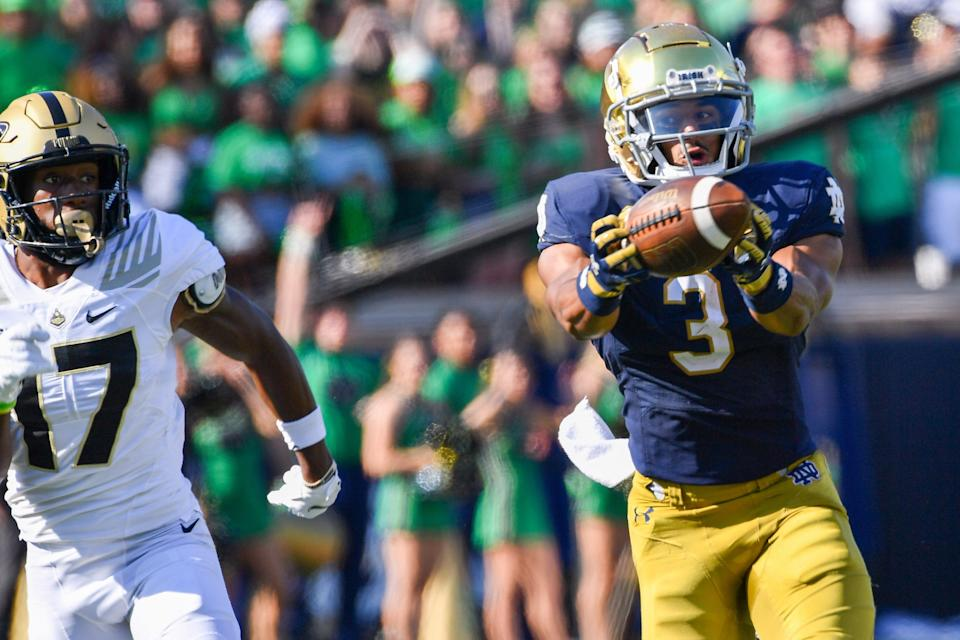 Notre Dame wide receiver Avery Davis catches a pass for a touchdown in front of Purdue safety Chris Jefferson.