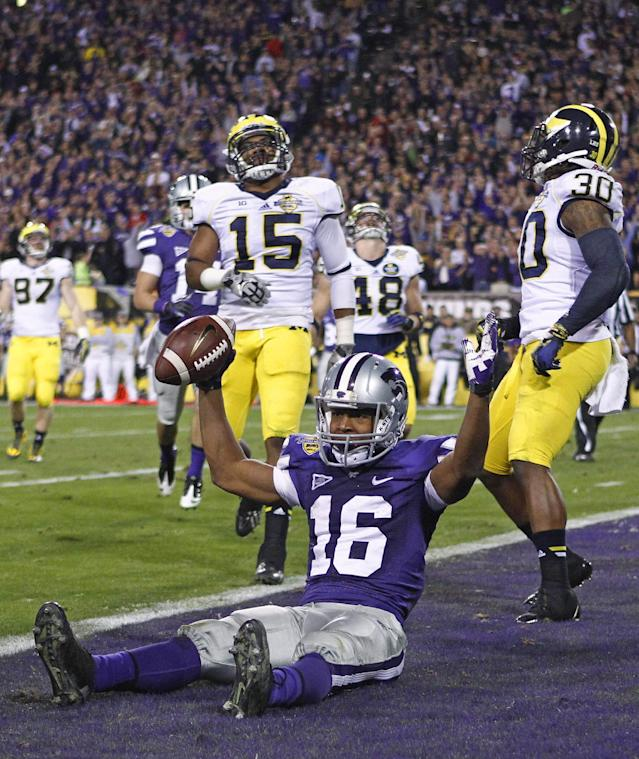 Kansas State wide receiver Tyler Lockett (16) celebrates after his third touchdown against Michigan, during the second quarter of the Buffalo Wild Wings Bowl NCAA college football game on Saturday, Dec. 28, 2013, in Tempe, Ariz. (AP Photo/The Arizona Republic, David Kadlubowski)