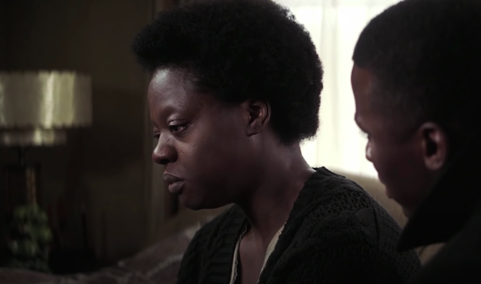 """A Tony already under her belt for <em>King Hedley II,</em> Davis had her first major film moment in her future collaborator <strong>Denzel Washington</strong>'s directorial debut, <em>Antwone Fisher</em>. Davis played Eva May, the titular protagonist's estranged mother, who gave him up after giving birth to him as an incarcerated teen. When Eva May finally reunites with Antwone (<strong>Derek Luke</strong>), she breaks your heart while <a href=""""https://www.youtube.com/watch?v=LW8CpOzdT5Q"""" rel=""""nofollow noopener"""" target=""""_blank"""" data-ylk=""""slk:barely saying a word"""" class=""""link rapid-noclick-resp"""">barely saying a word</a>. It's the first onscreen evidence of a truth that Davis would prove time and again: she can make a meal out of any role, no matter the size."""