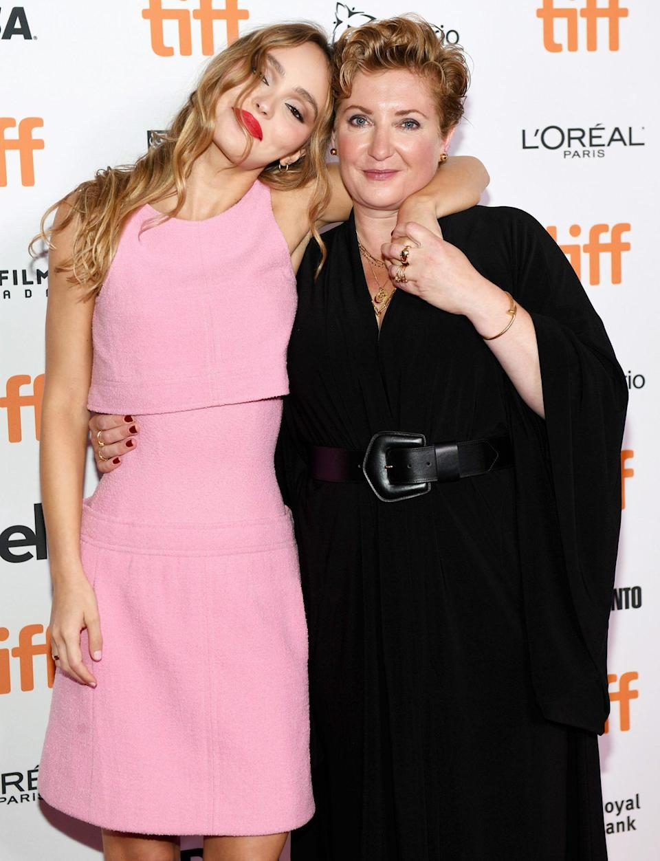 <p>Lily-Rose Depp and Camille Griffin keep close at the <em>Silent Night</em> premiere during the Toronto International Film Festival on Sept. 16. </p>