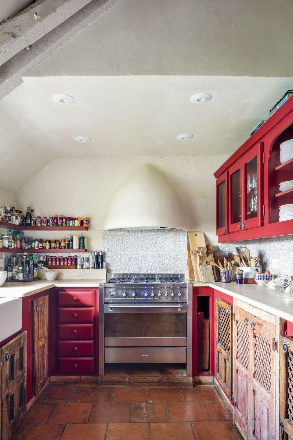 """<p>""""Our kitchen is partly made using reclaimed doors from a Spanish farmhouse we found, so we built some cupboards around them. We were able to restore the 16th century original terracotta pamments in many of the floors, they are incredibly uneven, and I love their imperfection.""""</p>"""