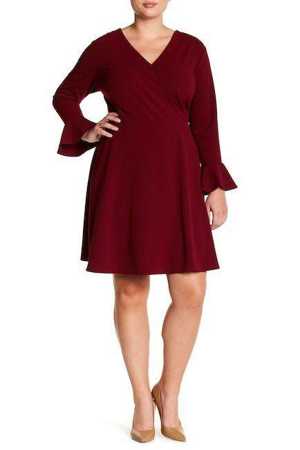 "From <a href=""https://www.nordstromrack.com/shop/product/2182327/alexia-admor-bell-sleeve-faux-wrap-dress-plus-size?color=BURGUNDY"" target=""_blank"">Nordstrom Rack</a>. Comes up to a size 3X."
