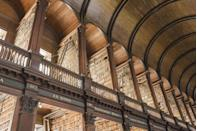 <p>The main building of this college library, known as the Old Library, was designed by Irish architect Thomas Burgh in 1712 and includes the Long room, pictured, a breathtaking expanse of arched bookshelves beneath a vaulted ceiling. This room alone houses 200,000 volumes. </p>