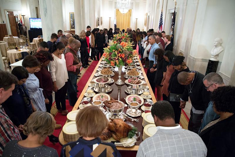 """""""President Obama leads a prayer before hosting Thanksgiving dinner [in 2016] for family and friends on the State Floor of the White House."""" (Photo: Official White House Photo by Pete Souza)"""