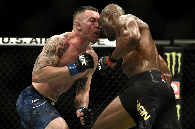 LAS VEGAS, NEVADA - DECEMBER 14: (R-L) Kamaru Usman of Nigeria butts heads with Colby Covington in their UFC welterweight championship bout during the UFC 245 event at T-Mobile Arena on December 14, 2019 in Las Vegas, Nevada. (Photo by Chris Unger/Zuffa LLC via Getty Images)