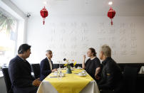 Mayor of London Sadiq Khan, second left, with chefs Angela Hartnett, second rightand Monica Galetti, right, have tea at Dumplings Legend, in China Town, central London, Monday, May 17, 2021. Pubs and restaurants across much of the U.K. are opening for indoor service for the first time since early January even as the prime minister urged people to be cautious amid the spread of a more contagious COVID-19 variant. (AP Photo/Alastair Grant)