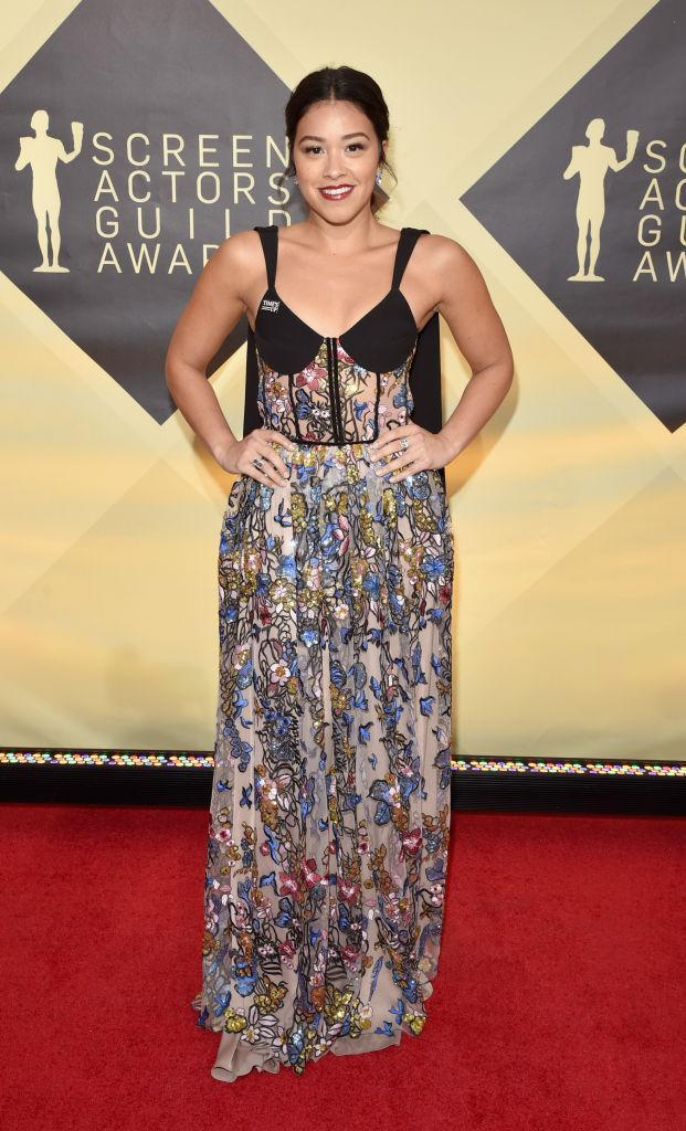 <p>Rodriquez wore a gorgeous floral dress with a corsetted bodice. (Photo: Getty Images) </p>