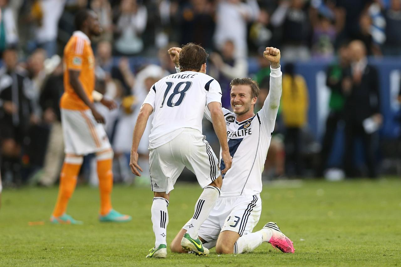 CARSON, CA - DECEMBER 01:  David Beckham #23 and Mike Magee #18 of Los Angeles Galaxy celebrate in the second half agaisnt the Houston Dynamo in the 2012 MLS Cup at The Home Depot Center on December 1, 2012 in Carson, California.  (Photo by Jeff Gross/Getty Images)
