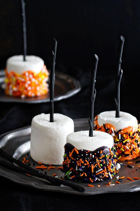 """<p>For wicked broomstick pops, dip marshmallows in melted chocolate candy and add festive sprinkles. </p><p><strong>Get the recipe at </strong><a href=""""http://www.mybakingaddiction.com/halloween-marshmallow-pops/"""" rel=""""nofollow noopener"""" target=""""_blank"""" data-ylk=""""slk:My Baking Addiction"""" class=""""link rapid-noclick-resp""""><strong>My Baking Addiction</strong></a>. </p>"""