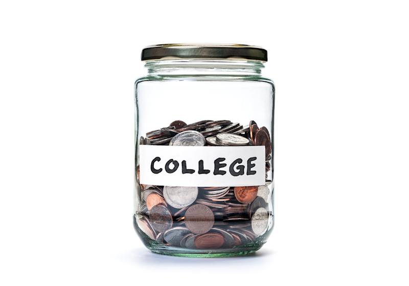 Glass jar, labeled college, filled halfway with coins.