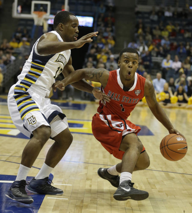 Ball State's Zavier Turner tries to drive past Marquette's Derrick Wilson during the second half of an NCAA college basketball game Tuesday, Dec. 17, 2013, in Milwaukee. (AP Photo/Morry Gash)