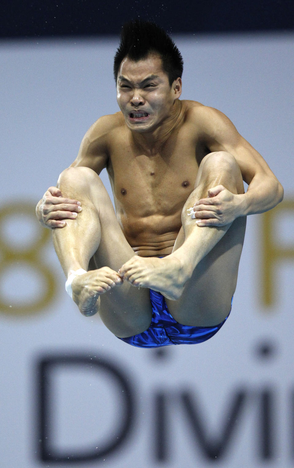 He Chong of China dives during the final of the Men's 3m Springboard at the FINA Diving World Cup at the Olympic Aquatics Centre in London February 22, 2012. He won the event. REUTERS/Andrew Winning (BRITAIN - Tags: SPORT DIVING OLYMPICS)