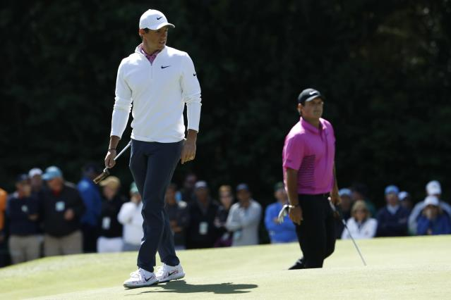 Rory McIlroy of Northern Ireland (L) and Patrick Reed of the U.S. walk on the 6th green during final round play of the 2018 Masters golf tournament at the Augusta National Golf Club in Augusta, Georgia, U.S. April 8, 2018. REUTERS/Jonathan Ernst