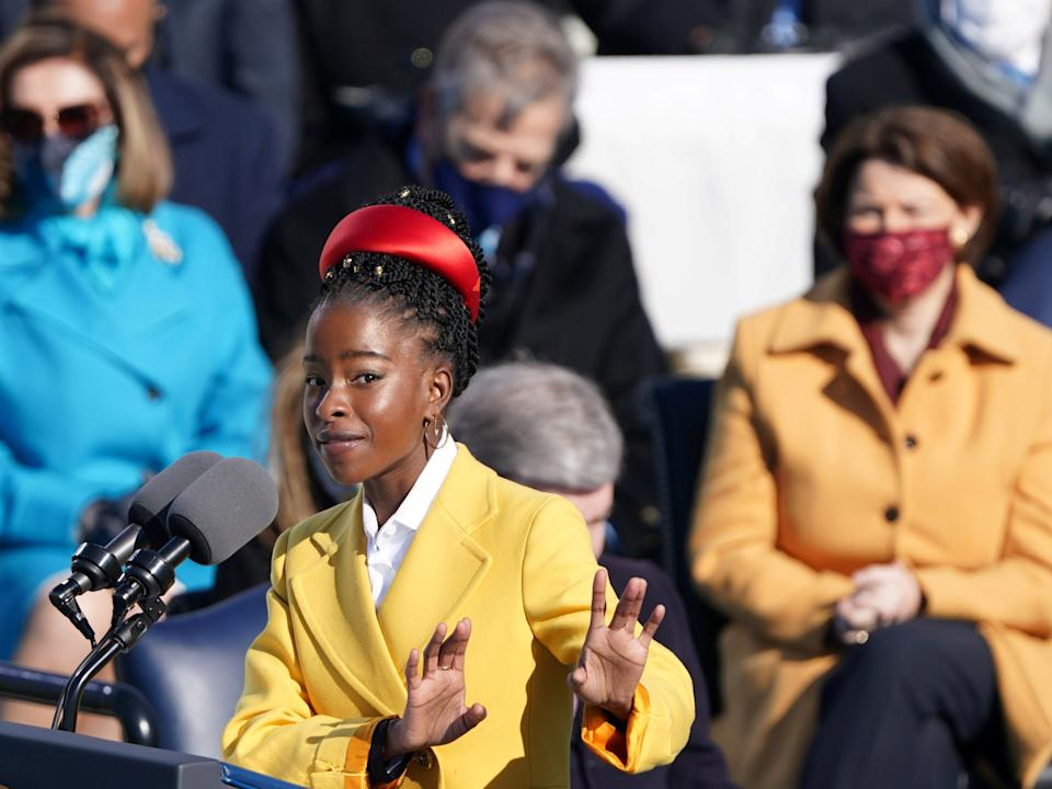 Amanda Gorman recites a poem during the inauguration of Joe Biden, referencing Biblical scripture and at times echoing the oratory of John F Kennedy and the Rev Martin Luther King Jr as she asked: 'Where can we find light/In this never-ending shade?'REUTERS