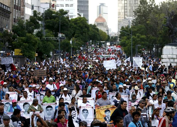 """<div class=""""inline-image__caption""""><p>Relatives gathered in Mexico City with pictures of their missing family.</p></div> <div class=""""inline-image__credit"""">REUTERS/Henry Romero</div>"""