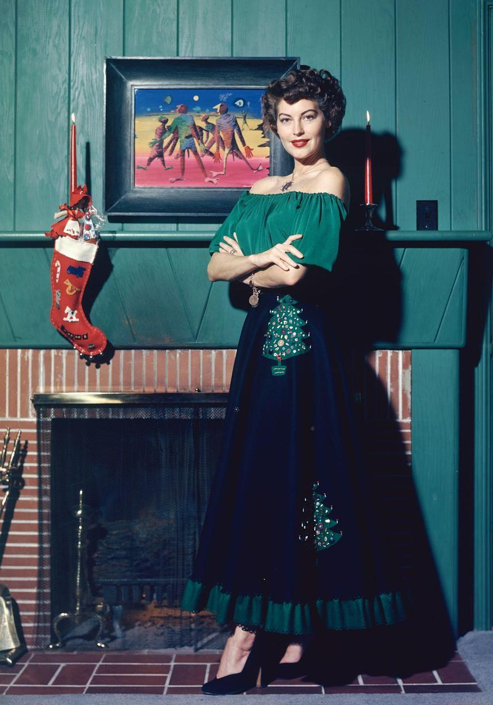 <p>Can we steal this look, Ava? The actress dressed in head-to-toe Christmas spirit as she poses near a stocking, hung by the chimney with care. </p>