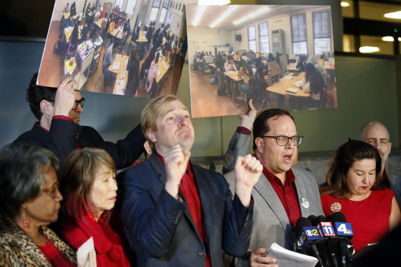 United Teachers Los Angeles union president Alex Caputo-Pearl, third from right, surrounded by union negotiators speaks during a news conference at the Los Angeles Unified School District headquarters in Los Angeles Friday, Jan. 11, 2019. A massive teachers strike in Los Angeles is still planned for Monday after a union rejected a new offer from the nation's second-largest school district and declared an impasse following 21 months of increasingly heated negotiations. (AP Photo/Damian Dovarganes)