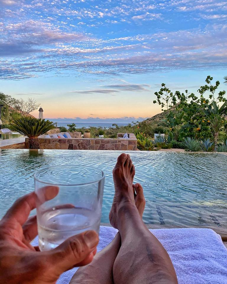 """<p>The<a href=""""https://people.com/tag/the-rock/""""><em>Jumanji</em>actor</a> chilled by the pool in Mexico while drinking a glass of his new liquor brand, <a href=""""https://people.com/food/dwayne-the-rock-johnson-unveils-his-new-tequila-teremana/"""">Teremana Tequila</a>. """"I rarely kick my Sasquatch feet up, but this liquid occasion called for it,"""" <a href=""""https://www.instagram.com/p/B5EsvHeFYHk/?igshid=15a0zidw2fxmg"""">he joked</a>. """"Cheers to a productive work week, my friends.""""</p>"""
