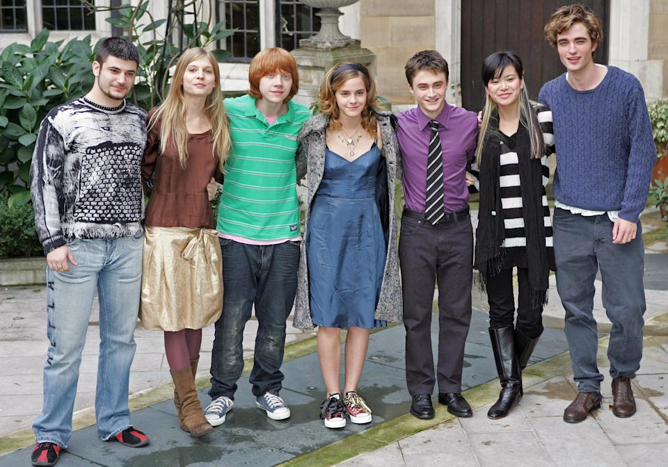 """British actors (L to R) Stanislav Ianevski who plays Viktor Krum, Clemence Poesy who plays Fleur Delacour, Rupert Grint who plays Ron Weasley, Emma Watson who plays Hermione Granger, Daniel Radcliffe who plays Harry Potter, Katie Leung who plays Cho Chang and Robert Pattinson who plays Cedric Diggory in the forthcoming film """"Harry Potter and the Goblet of Fire"""" attend a photocall in London October 25, 2005. The film which is the fourth in the series of Harry Potter films based on the books by British author JK Rowling will premiere in London on November 6. REUTERS/Toby Melville"""