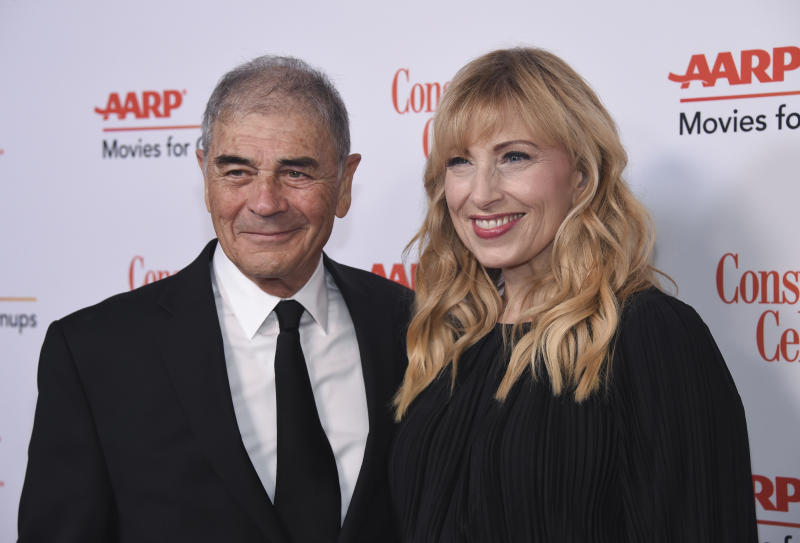 "FILE - In this Jan. 4, 2019 file photo, Robert Forster, left, and Denise Grayson attend the 18th Annual Movies For Grownups Awards at Beverly Wilshire Hotel, in Beverly Hills, Calif. Forster, the handsome character actor who got a career resurgence and Oscar-nomination for playing bail bondsman Max Cherry in ""Jackie Brown,"" has died at age 78. Forster's agent Julia Buchwald says he died Friday, Oct. 11, 2019, at home in Los Angeles of brain cancer. (Photo by Phil McCarten/Invision/AP, File)"