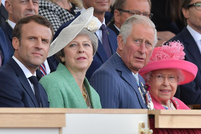 (L-R) French President Emmanuel Macron, Britain's Prime Minister Theresa May, Britain's Prince Charles, Prince of Wales and Britain's Queen Elizabeth II attend an event to commemorate the 75th anniversary of the D-Day landings, in Portsmouth, southern England, on June 5, 2019. - US President Donald Trump, Queen Elizabeth II and 300 veterans are to gather on the south coast of England on Wednesday for a poignant ceremony marking the 75th anniversary of D-Day. Other world leaders will join them in Portsmouth for Britain's national event to commemorate the Allied invasion of the Normandy beaches in France -- one of the turning points of World War II. (Photo by Daniel LEAL-OLIVAS / AFP) (Photo credit should read DANIEL LEAL-OLIVAS/AFP via Getty Images)