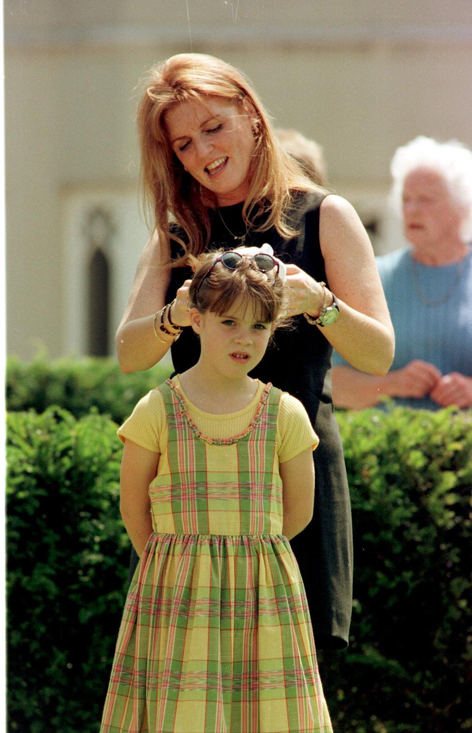 Princess Eugenie at eight with her mother. (PA Images)