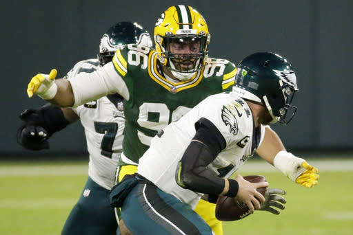 Green Bay Packers' Kingsley Keke sacks Philadelphia Eagles' Carson Wentz during the first half of an NFL football game Sunday, Dec. 6, 2020, in Green Bay, Wis. (AP Photo/Mike Roemer)