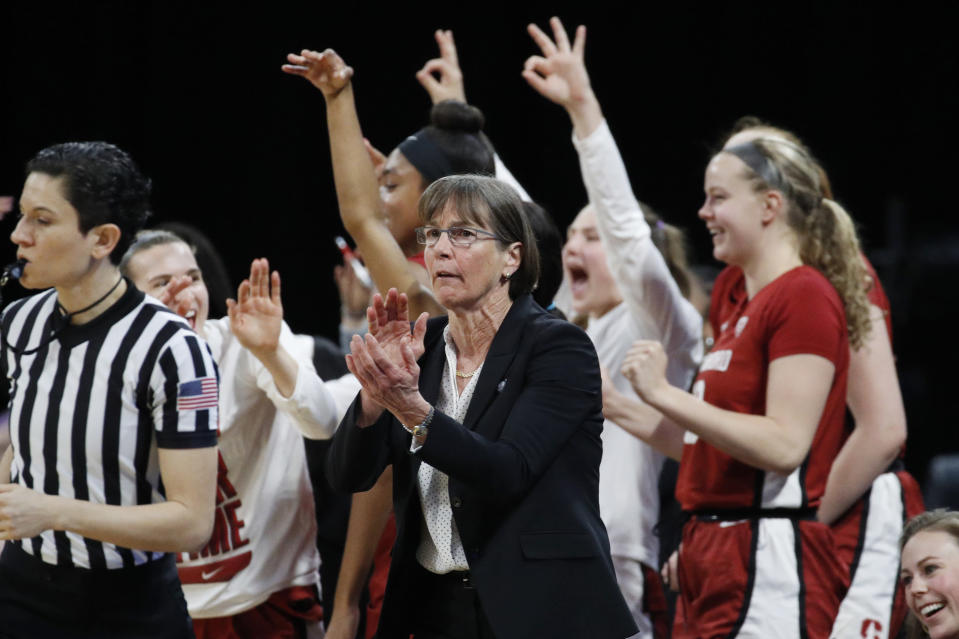 FILE - In this March 7, 2020, file photo, Stanford head coach Tara VanDerveer, center, reacts with her team during the second half of an NCAA college basketball game against UCLA in the semifinal round of the Pac-12 women's tournament in Las Vegas. Stanford is ranked No. 2 in the women's NCAA college basketball poll released Tuesday, Nov. 10, 2020.(AP Photo/John Locher, File)