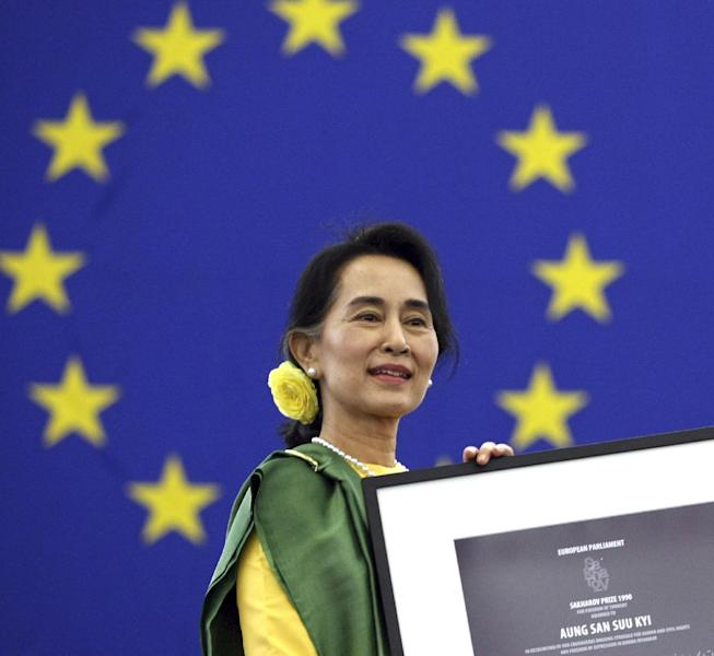 Aung San Suu Kyi, Myanmar's Nobel Peace Prize laureate and long-time political prisoner, finally receives the European Union's 1990 Sakharov Prize for human rights at the European parliament in Strasbourg eastern France Tuesday Oct 22, 2013. Suu Kyi has persevered for decades in promoting democracy. She and her National League for Democracy party were frozen out of politics by the military regime that governed until 2011, and last year she and several dozen party members won parliamentary seats. (AP Photo/Christian Lutz)