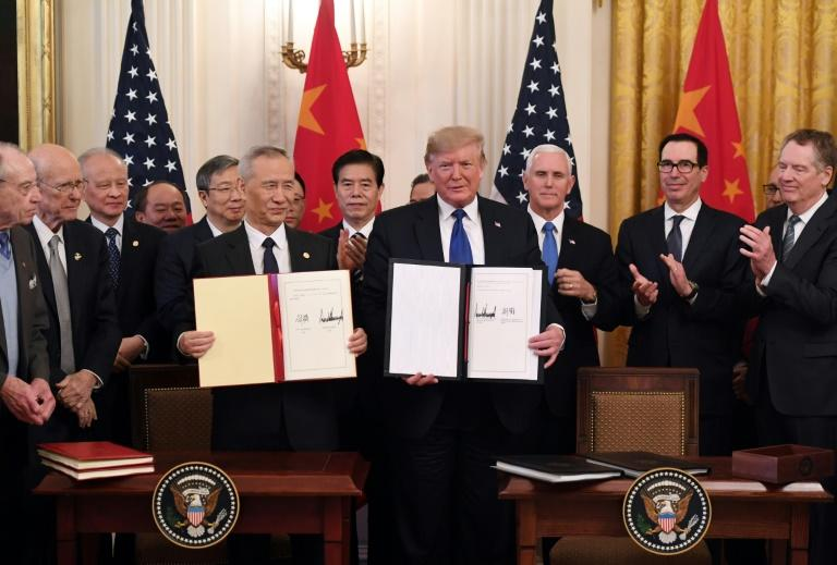 "The ""phase one"" trade agreement signed by the United States and China prevented some damaging tariffs from taking effect, but duties remain in place on about two-thirds of goods traded between the two economic powers"