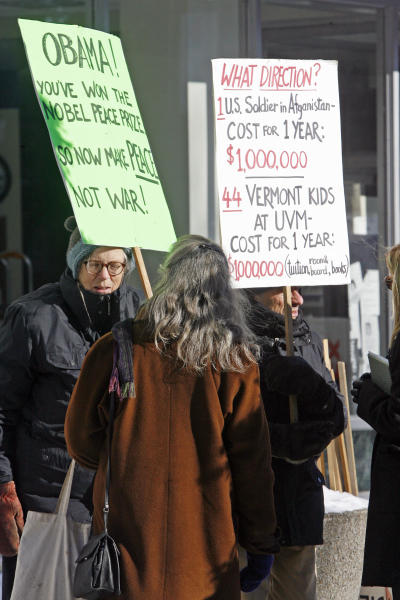 In this Dec. 18, 2009 photo, protesters hold signs in front of the federal building in Montpelier, Vt. More than a decade after anti-war protesters started a weekly vigil in front of the Montpelier post office, they keep coming. Sometimes only a handful, but ever since the U.S. invaded Afghanistan they have come. They've outlasted the U.S. war in Iraq. (AP Photo/Toby Talbot)