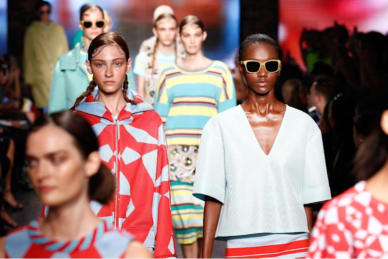 Models walk the runway at the DKNY show during New York Fashion Week on September 7, 2014