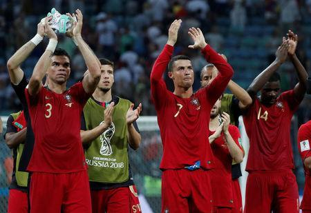Soccer Football - World Cup - Group B - Portugal vs Spain - Fisht Stadium, Sochi, Russia - June 15, 2018 Portugal's Cristiano Ronaldo, Pepe and team mates applaud the fans at the end of the match REUTERS/Murad Sezer