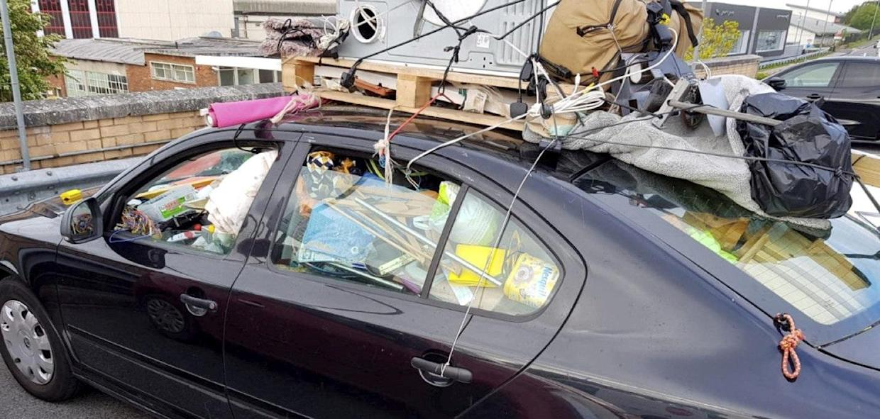 The overloaded car was pulled over by police on Friday (swns)