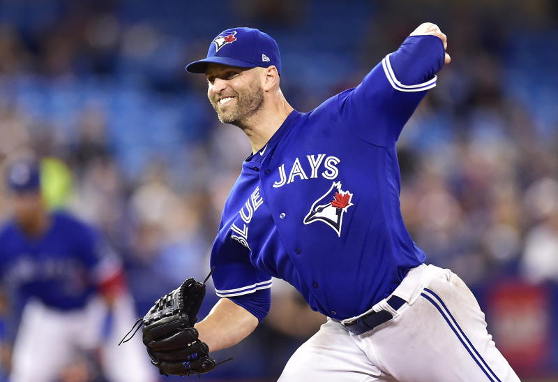 Veteran pitcher J.A. Happ was traded to the ..... on ..... (AP)