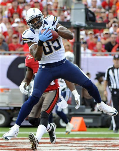 San Diego Chargers tight end Antonio Gates (85) pulls in a 13-yard first quarter touchdown pass in front of Tampa Bay Buccaneers strong safety Mark Barron (24) during an NFL football game Sunday, Nov. 11, 2012, in Tampa, Fla. (AP Photo/Brian Blanco)