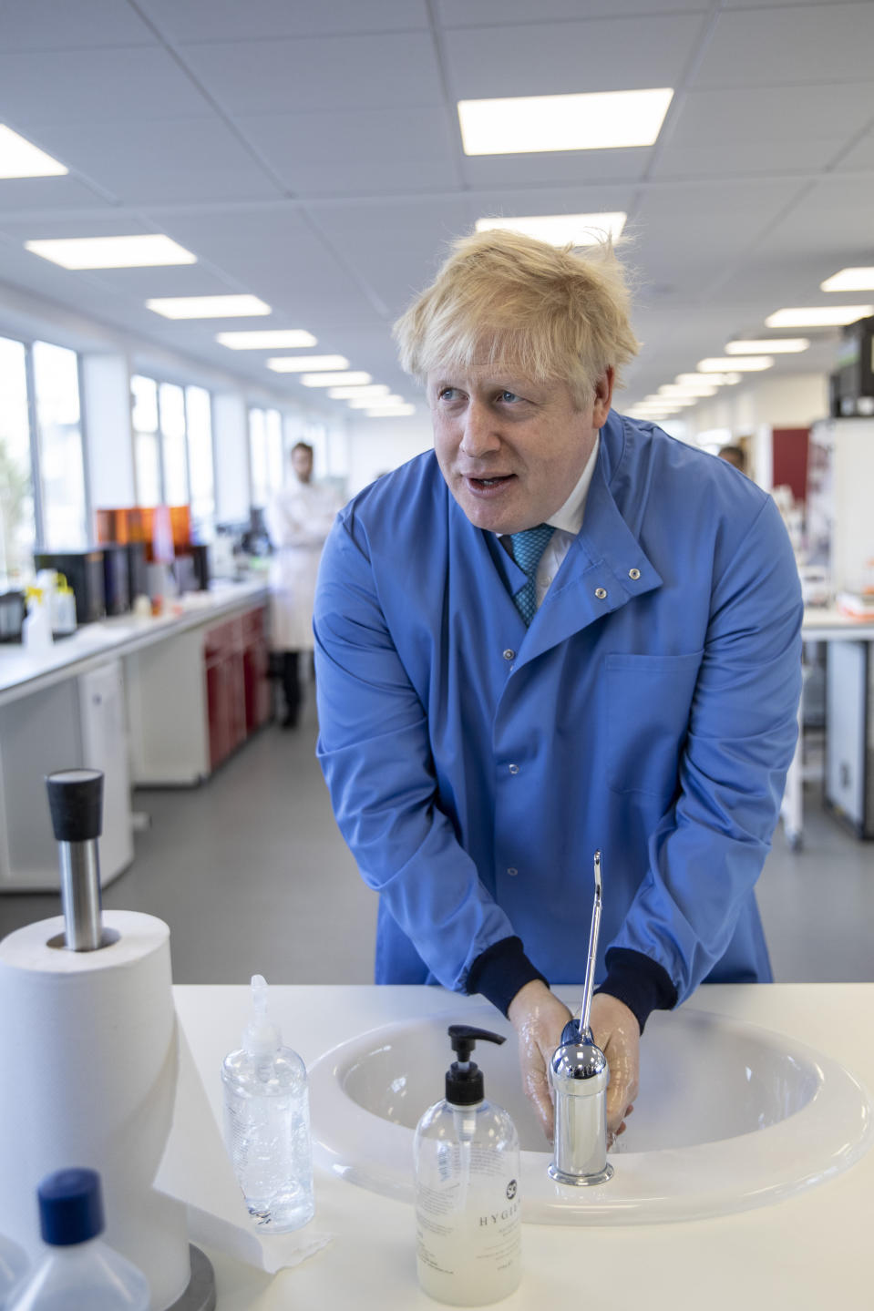 FILE - In this Friday March 6, 2020 file photo Britain's Prime Minister Boris Johnson washes his hands as he visits the Mologic Laboratory in the Bedford technology Park, England. Britain botched its response to the coronavirus the first time around. Now many scientists fear it's about to do it again. The virus is on the rise again in the U.K., which has recorded almost 42,000 COVID-19 deaths, with confirmed infections at their highest level since May. (Jack Hill/Pool via AP, File)