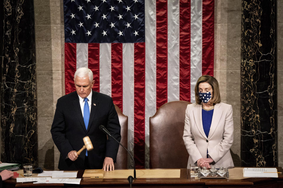 Speaker of the House Nancy Pelosi, D-Calif., and Vice President Mike Pence officiate as a joint session of the House and Senate on Wednesday, Jan 6, 2021. (Erin Schaff/The New York Times via AP, Pool)