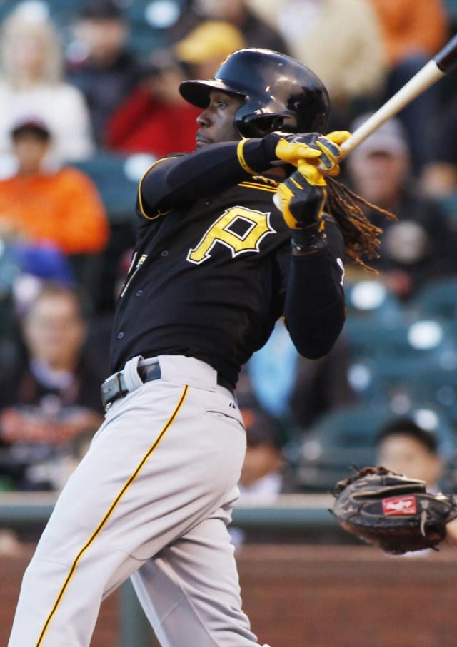 Pittsburgh Pirates' Andrew McCutchen follows through on an RBI single against the San Francisco Giants during the first inning of a baseball game in San Francisco, Thursday, Aug. 22, 2013. (AP Photo/George Nikitin)