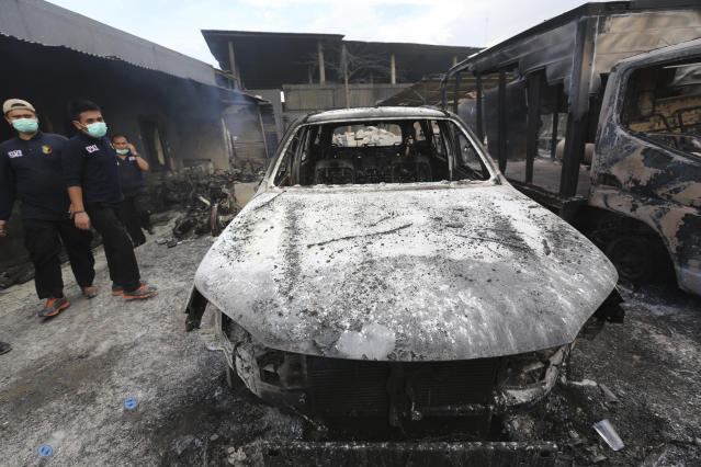 <p>Rescuers inspect burnt out cars at the site of an explosion at a firecracker factory in Tangerang, on the outskirt of Jakarta, Indonesia, Thursday, Oct. 26, 2017. The explosion and raging fire killed a number of people and injured dozens, police said. (Photo: Tatan Syuflana/AP) </p>