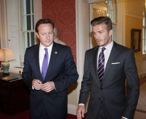 Britain's prime minister David Cameron (L) meets with soccer player David Beckham at Downing Street in London. Cameron insisted Thursday that Britain would deliver a memorable Olympics after US presidential hopeful Mitt Romney backtracked on barbed comments he made about the London Games