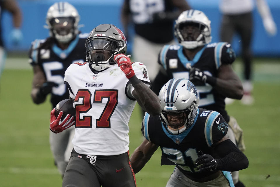 Tampa Bay Buccaneers running back Ronald Jones (27) runs for a 98-yard touchdown against the Carolina Panthers. (AP Photo/Gerry Broome)