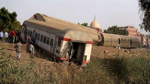 PHOTO: People gather at the site where train carriages derailed in Qalioubia north of Cairo, Egypt, April 18, 2021. (Mohamed Abd El Ghany/Reuters)