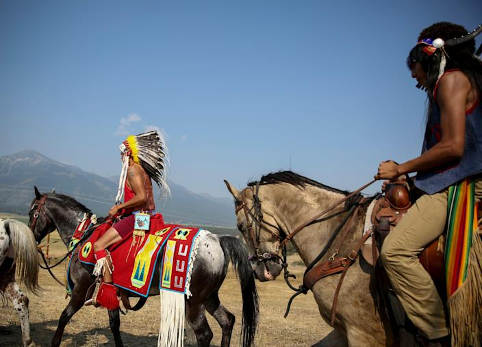 """Members of the Nez Perce Tribe ride on Am'sáaxpa or """"the place of boulders,"""" for a land blessing ceremony on Thursday, July 29, 2021 in Joseph, Ore. The tribe purchased 148 acres of ancestral land in December 2020, over a century after being pushed out of the area."""