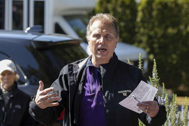 PHOTO: In this March 18, 2020, file photo, Scott Sedlacek commends the recent work of health care workers as he speaks to a spokesman for the Live Care Center in Kirkland, Wash. (Karen Ducey/Getty Images, FILE)
