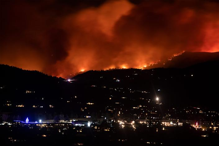 Flames from the Cameron Peak Fire, the largest wildfire in Colorado history, burn trees along a ridge outside Estes Park, Colo. on Friday, Oct. 16, 2020.