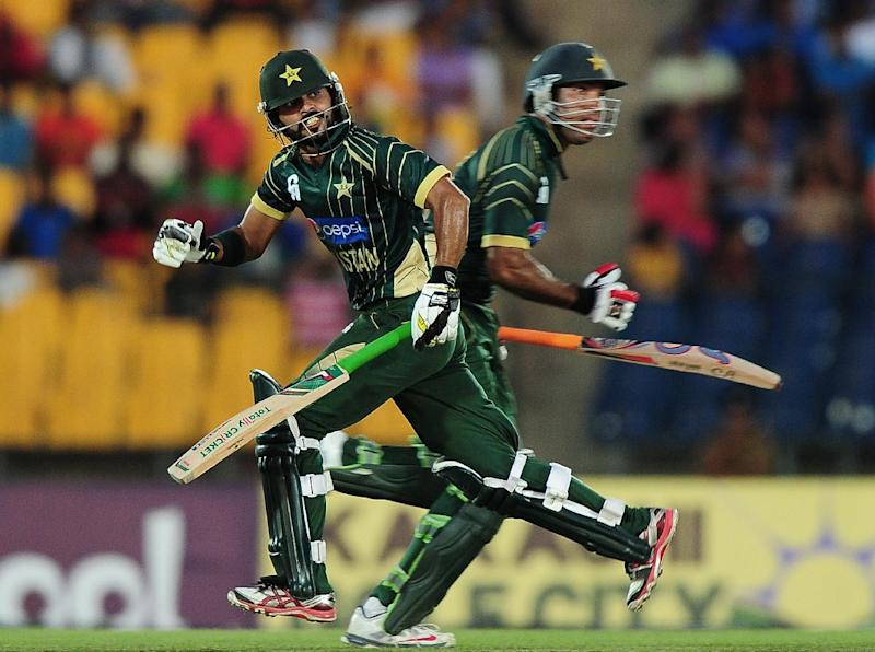 Pakistan batsman Fawad Alam (L) and Sohaib Maqsood (R) during the first One Day International (ODI) match between Sri Lanka and Pakistan in the southern district of Hambantota on August 23, 2014