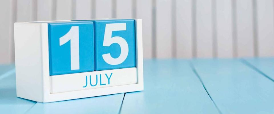 Image of july 15 wooden color calendar on white background.